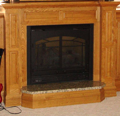 Wood fireplace mantel and hearth