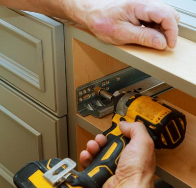 Installation professional installing kitchen cabinets