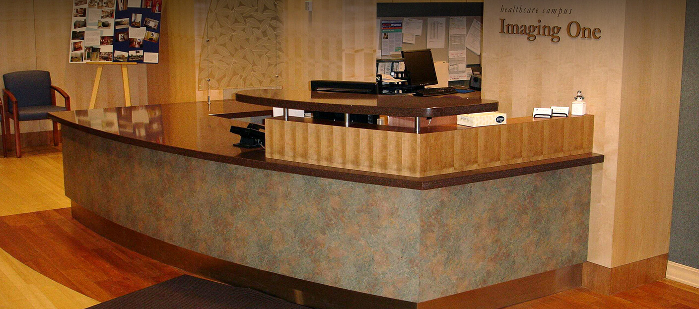 Custom engineered and fabricated reception desk created by Southern Minnesota Woodcraft for Imaging One
